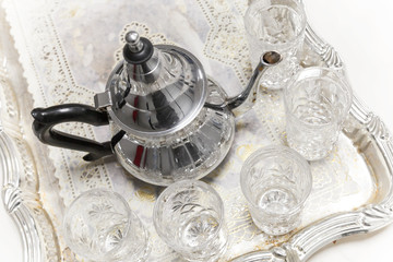 Moroccan tea theme. Metal Arabic teapot with glasses