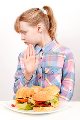 Little blond Caucasian girl saying hamburgers: No