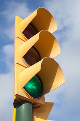 Yellow traffic light shows green allowed signal