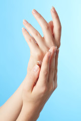 Woman's hands in moisturizer cream