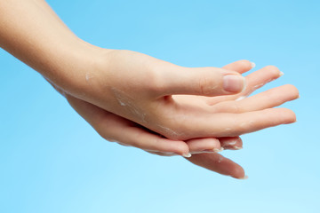 Woman's hands in moisturizer cream