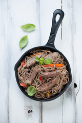 Frying pan with a national japanese cuisine yakisoba, above view