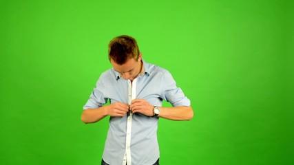 man - green screen - portrait - man unbuttoned his shirt