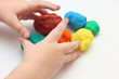 Child playing with playdough - 71721298