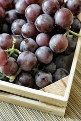 Red grapes bunch into box