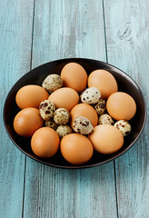 Eggs in a black bowl on a turquoise vintage surface