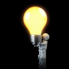 3d man holding a light bulb