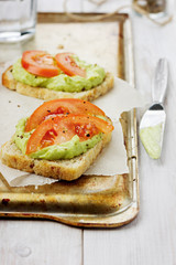 Avocado cream with toasts and tomatoes