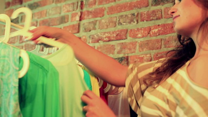 Woman looking and trying clothes in the shop