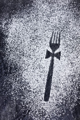 Fork imprint with a bow made in icing sugar