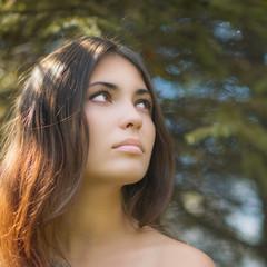 Portrait of a beautiful brunette. Close-up.