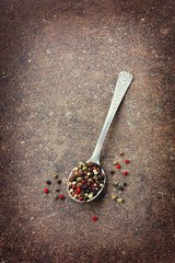 Peppercorn in spoon on a vintage surface