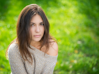 Portrait of young beautiful woman in sweater.