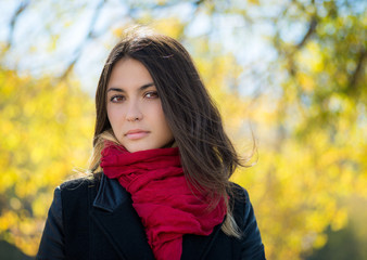 Young woman in a jacket with red scarf. Autumn portrait.