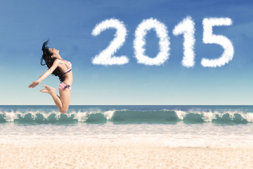 Attractive woman celebrate new year on beach