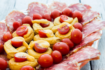 Taralli piccanti with tomato mayonnaise and salami