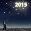 Businesswoman pulling number of 2015