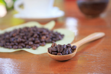 coffee beans on wood spoon