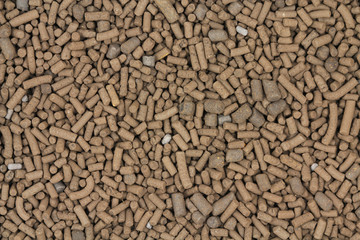 Big brown catalyst pellets abstract background