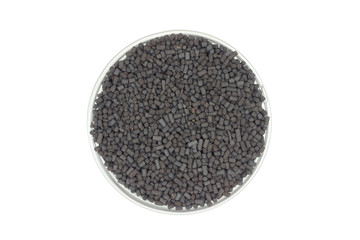 black catalyst pellets in a glass container