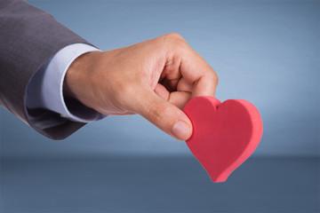 Hand holding heart shape