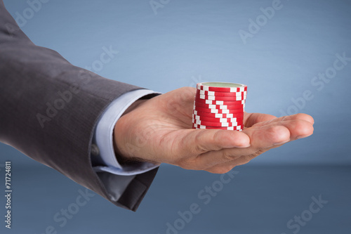 canvas print picture Hand holding casino chips