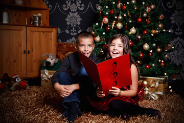 Little children singing a song at Christmas Eve