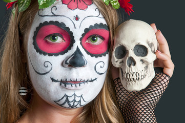 Girl with Calavera Mexicana makeup mask. Helloween
