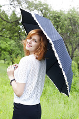 smiling girl with umbrella