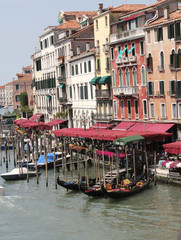 Traditional Venice gondola parked in the water