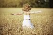 happy girl enjoying life  in wheat field in summer