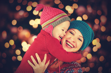 happy family mother and  daughter playing in Christmas