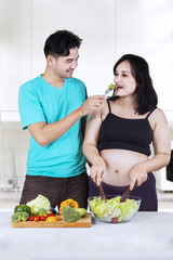 Man giving healthy food to his wife