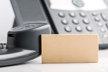 Empty Small Wooden Sign on Telephone Desk