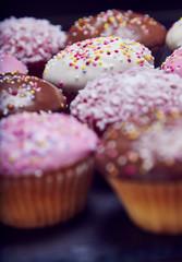 Cupcakes close up on black slate