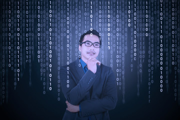 Thougthful businessman with binary code