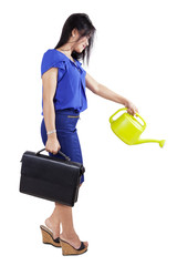 Woman and a watering can