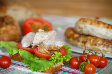 sandwich with tomatoes and homemade sausage