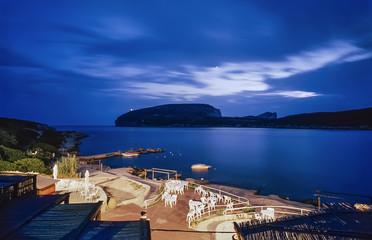 Italy, Sardinia, Alghero, the Capo Caccia promontory at sunset
