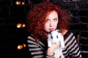 Beautiful woman holding white rabbit