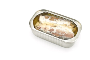 Sardines in opened tin can isolated on white