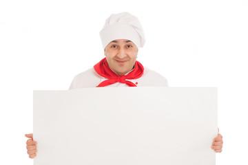 happy chef in white uniform standing over black billboard