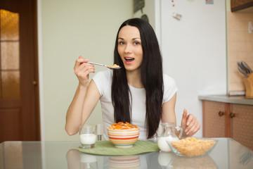 brunette girl eating breakfast with milk