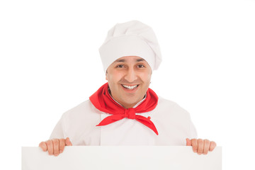 happy chef in white uniform standing over black billboard