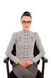 brunette woman in shirt and trousers sitting in office chair
