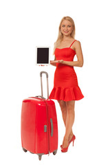 girl wearing red dress holding tablet with big suitcase