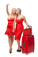 two girls wearing red dresses with big suitcase and bag  making