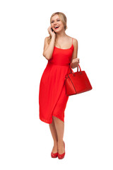 woman in red dress holding big bag  talking on the cell phone