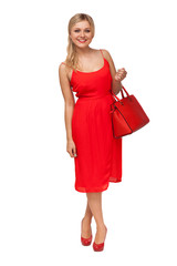 blonde beautiful woman in red dress holding big bag