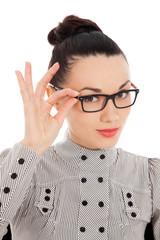 amazed brunette holding her glasses